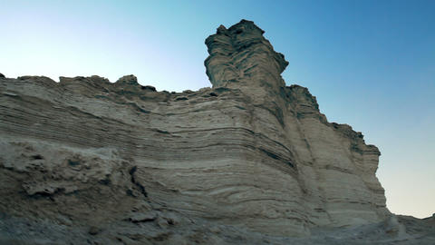Stock Footage of a gray layered rock formation in the desert in Israel Footage