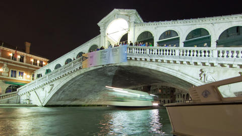 Panning shot of A Rialto bridge time-lapse from side of canal Footage