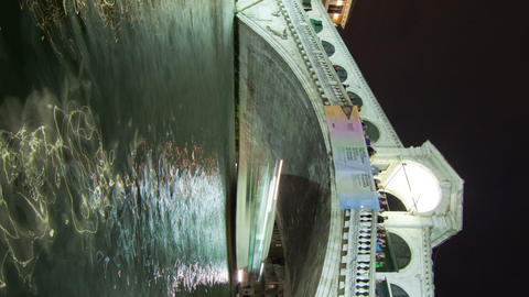 Vertical shot of A Rialto bridge time-lapse from side of canal Footage
