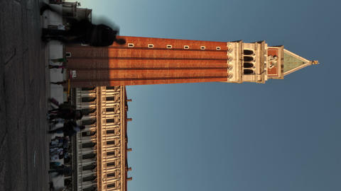 Vertical time-lapse of the tower in Saint Mark's Square as sunset shadows grow Footage
