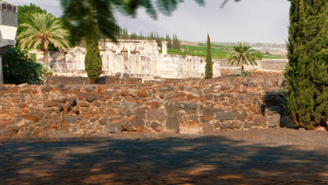 Panning shot of Time-lapse of the old synagogue in Capernuam, Israel Footage