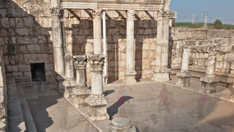 Panning shot of Dolly time-lapse of tourists at the old synagogue in Capernuam,  Footage