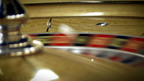 Close up of a roulette table spinning with the ball Footage