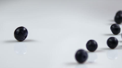 Blueberries falling onto a table Footage