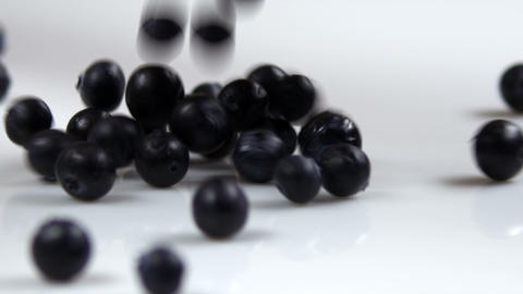 Clip of blueberries falling onto a table Footage