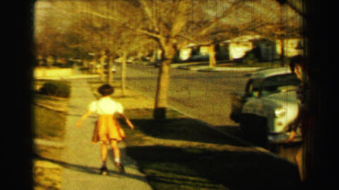 1958: Teenage girl curly perm hair polka dot blouse small orange shorts Footage