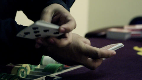 Pulling aces from a fanned deck of cards Live Action