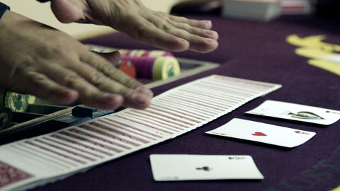 Fanning cards in two hands, showing, then replacing Footage