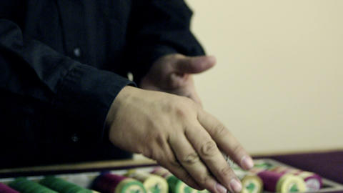 Playing card tricks and disappearing chips on the gambling table Footage
