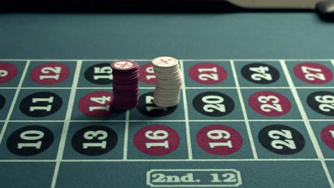 Chips being piled onto a roulette table Footage