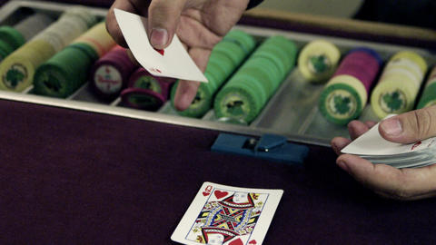 Dealer spinning a card through his fingers Footage