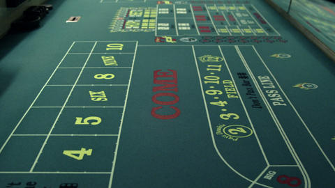 Dice rolling across a craps table Live Action
