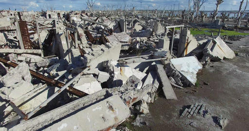 Drone scene, destroyed city, catastrophe. Flying close to concrete seat. Rises t Live Action