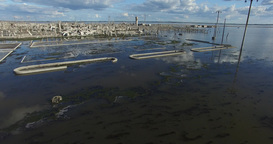 Aerial drone scene of flooded destroyed city. Epecuen. Natural disaster. Detail Footage