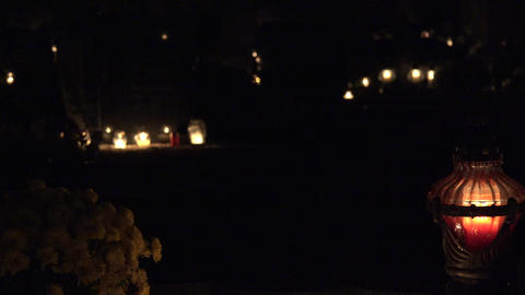 candle light, chrysanthemum flower on grave ground in night. 4K Footage