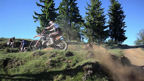 Men who jumps motocross bike over mounds of earth 04 Footage