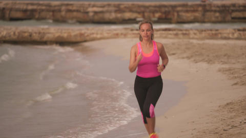 7-Active Girl Doing Fitness Running On Beach Footage