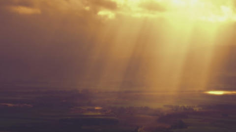 Stock Video Footage of sun rays illuminating a valley through clouds shot in Isr Footage
