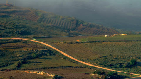 Royalty Free Stock Video Footage of pastoral hills and clouds shot in Israel at  Footage