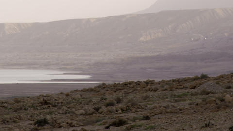Royalty Free Stock Video Footage of a hazy Dead Sea shoreline shot in Israel at  Footage
