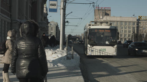 Winter city landscape. People waiting for public transport .People stand on the Footage