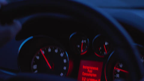 Car dashboard, control panel during automobile drive at dusk Footage