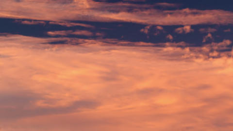 Royalty Free Stock Video Footage of white and orange clouds at sunset shot in Is Footage