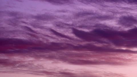 Royalty Free Stock Video Footage of purple clouds at sunset shot in Israel at 4k Footage