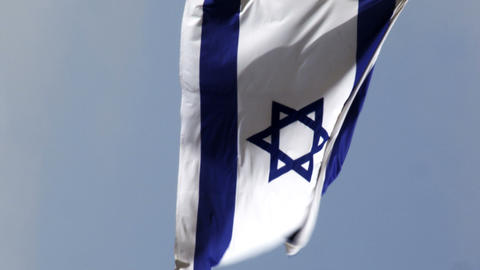 Stock Video Footage of an Israeli flag waving in the breeze filmed in Israel at  Footage