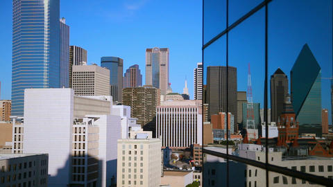 Dallas skyline reflected off a window during the day Live Action