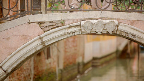 Close up of an arched bridge over a canal Footage