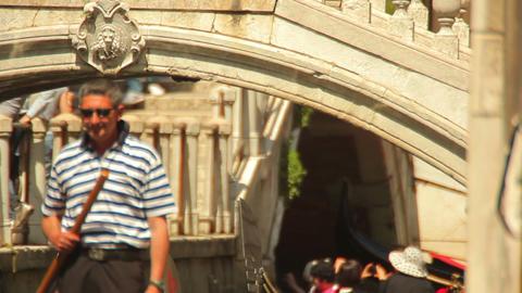 Gondoliers steer their gondolas Footage