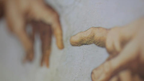 Racking close up of The Creation of Adam Footage