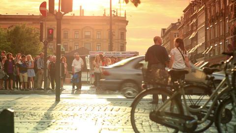 Static shot of pedestrians about to cross a busy street in Copenhagen, Denmark Footage