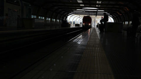Train arriving in a dim tunnel in Italy Footage
