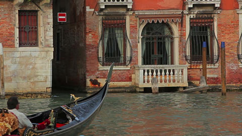 Gondolier steering through canal with passenger Footage