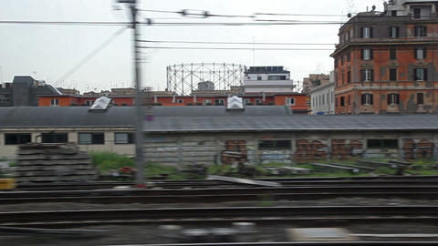 Passing shot of City with metal scrap piles and multistory complexes Footage
