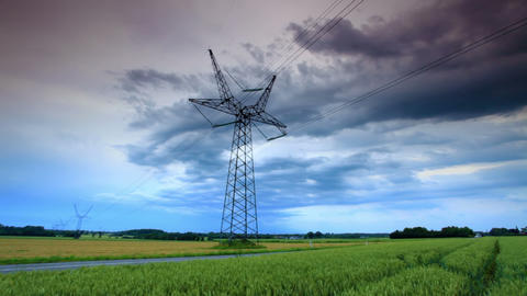 Tracking shot of an electricity tower along a road in the countryside at Copenha Footage