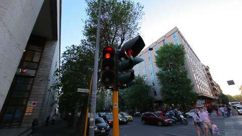 A corner stoplight stays a consistent red as people cross the street Footage