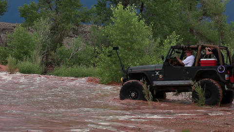 Distant jeep driving in water Footage