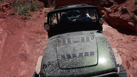 Jeep driving through rocky terrain in Moab Live Action