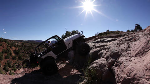 Jeeps Attempts to Scale Large Rock Footage