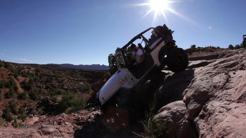 Jeep Getting Down Off Rock Footage
