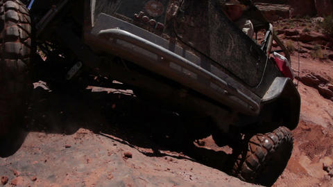 Jeep almost makes it up a steep cliff Live Action