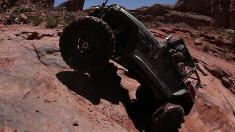 Jeep bouncing up a very steep incline Footage