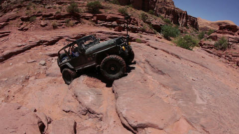 A jeep almost falling over while climbing Footage