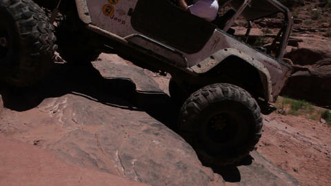 Driver of Jeep Climbs up Rocks Footage
