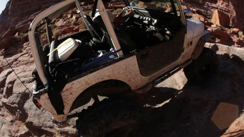 Jeep drives up bumpy ridge Footage