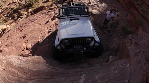 Jeep Attempts to Climb an Almost Vertical Rock Face Footage