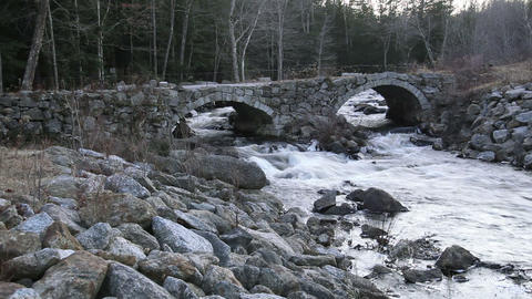 Small river under stone bridge Footage